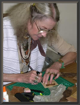 Suzanne cutting a picture
