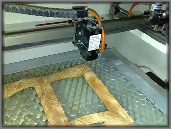 Laser marquetry cutter view of cutter bed