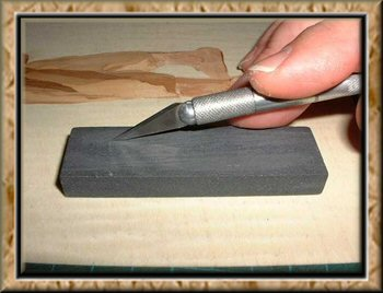 Photo: The blade being ground back on an oil stone