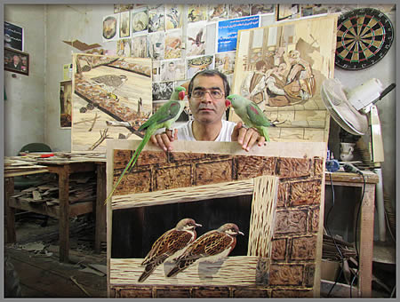 Hamid with two marquetry models!